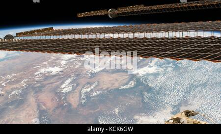 NASA International Space Station Expedition 50 astronauts capture the ISS Solar Arrays in the forefront of a satellite - Stock Photo