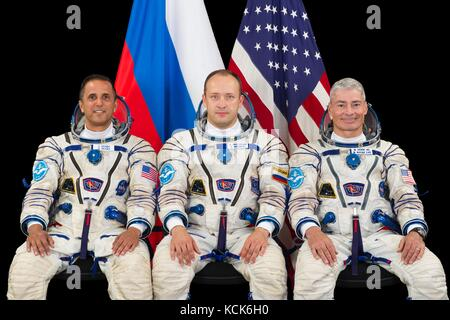Official portrait of NASA International Space Station Expedition 53/54 prime crew members (L-R) American astronaut - Stock Photo
