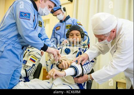 NASA International Space Station Expedition 52 prime crew member American astronaut Randy Bresnik is helped into - Stock Photo