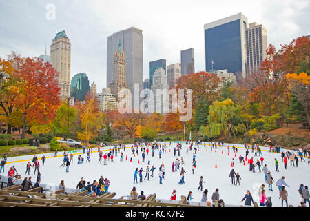 Ice skaters in New York central park during the fall - Stock Photo