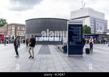 Commuters walking in King's cross Square near the underground and subway entrance, London, UK - Stock Photo