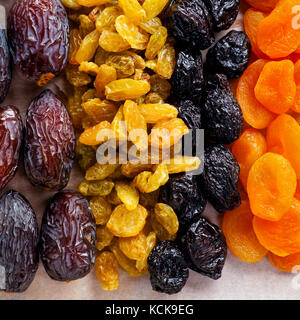 dried fruit mix on a wooden table - Stock Photo