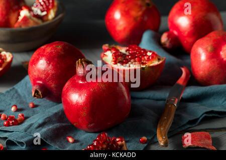 Raw Red Organic Pomegranates Splt in Half - Stock Photo
