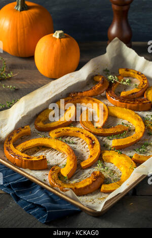 Sweet Homemade Roasted Pumpkin Slices with Thyme and Pepper - Stock Photo