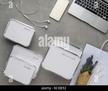 set of fast food with a laptop on a gray background. food for businessman and busy people - Stock Photo