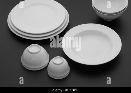 kitchen and restaurant utensils, plates, on a dark background - Stock Photo