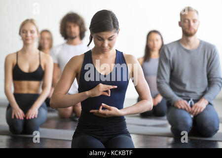 group of friends doing pilates kneeling glutes exercises