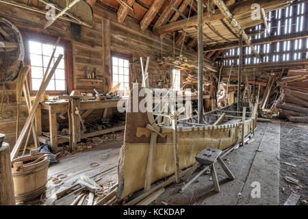 Birch bark canoe under construction in the Canoe Shed building, Fort William Historical Park, Thunder Bay, Ontario, Canada. Stock Photo