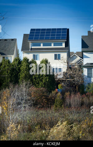Detached single family house with solar panels - Stock Photo