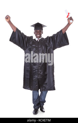 Graduation Man With Diploma Raising Hand Over White Background - Stock Photo