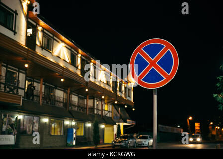 No parking traffic sign with blurred background - Stock Photo
