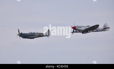 A pair Supermarine Spitfires PV202 and SM845 flying in formation at the Battle of Britain air show at the IWM Duxford - Stock Photo