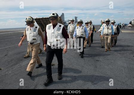 U.S. Energy Secretary Rick Perry (right) walks on the flight deck aboard the U.S. Navy Nimitz-class aircraft carrier - Stock Photo