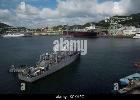 The U.S. Navy Avenger-class mine countermeasures ship USS Chief departs Fleet Activities Sasebo August 31, 2017 - Stock Photo