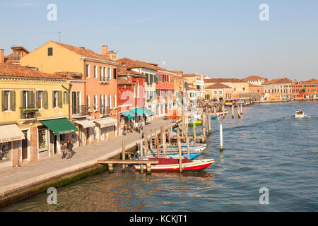 Murano Island, Venice,  Veneto, Italy, View along Riva Longa at sunset with colorful, buildings and moored boats - Stock Photo