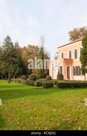 San Servolo island, Venice, Italy. View of a Venice International University residence set in a lush green park - Stock Photo
