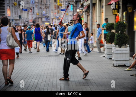 Street Busker Performing in Istiklal street - Stock Photo