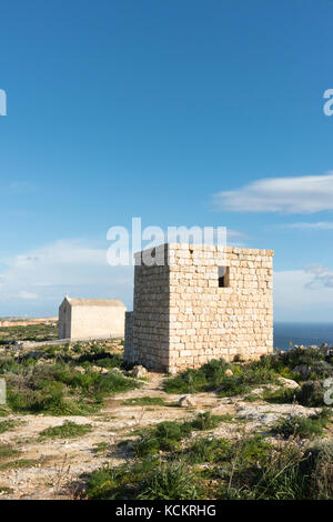 A stone watchtower and the Magdelene Chapel on the Dingli Cliffs Malta - Stock Photo