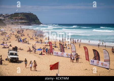 People on Mereweather Beach prior to the commencement of the 2016 Surfest final in Newcastle, Australia. - Stock Photo