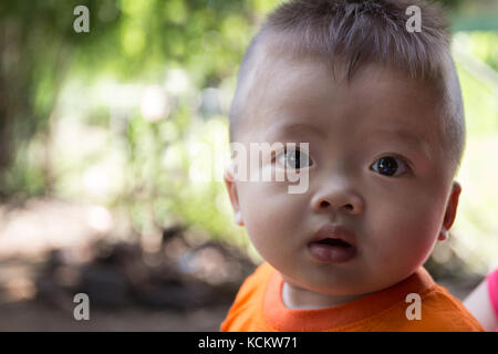 Adorable Child with Blonde Hair Looks Surprised before the Camera to Have His Closeup Portrait Taken. - Stock Photo