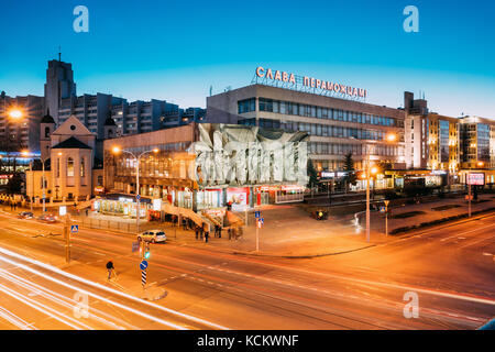 Minsk, Belarus - April 3, 2017: Evening Night Traffic Near Cathedral of Saints Peter and Paul and Bas-relief of - Stock Photo