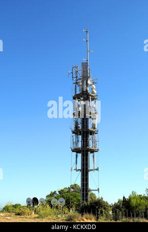 Modern mobile phone, or cellphone, communications mast or tower, with carious aerials and satellite dishes and receivers - Stock Photo