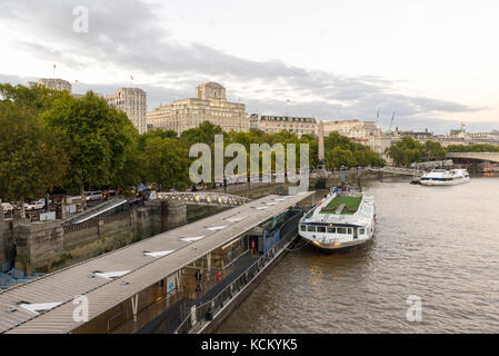 Looking east towards Victoria Embankment and the Savoy Hotel from Hungerford Bridge over the River Thames, London, - Stock Photo