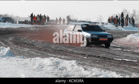 Rally car goes on dirt. ars go off-roading in race. Rally car going down slope in race at Sun City. Dirty rural - Stock Photo