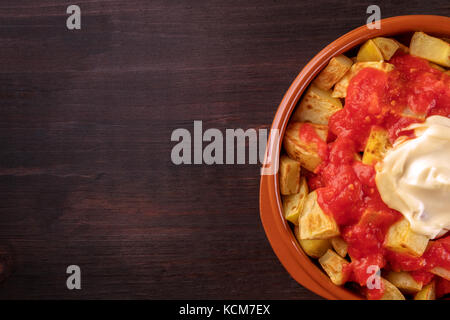 Patatas bravas, Spanish potato dish, overhead closeup shot - Stock Photo