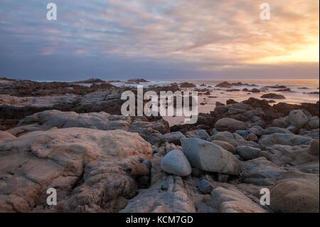 Rocky landscape along the Monterey Peninsula, California coast, at sunset. - Stock Photo