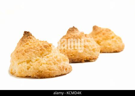 Delicious spanish coconut meringue cookies (coconut macaroons or sultanas de coco) on white background - Stock Photo