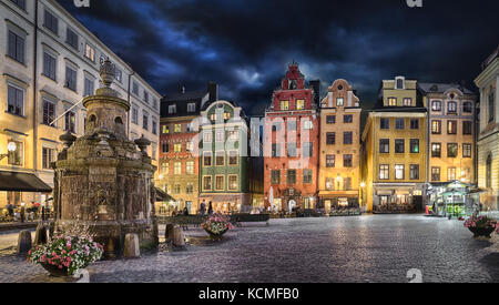 Stortorget square with colorful couses in the center of Old Town (Gamla Stan) of Stockholm, Sweden at dusk - Stock Photo