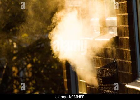 CO2 emmissions escaping from Gas Central heating in Domestic house . - Stock Photo