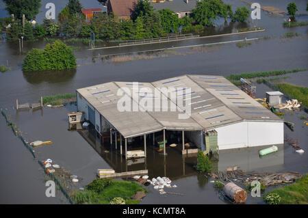 GERMANY, SAXONY-ANHALT - Juno 12, 2013: Flooded company near Fischbeck in Saxony-Anhalt, Germany. - Stock Photo