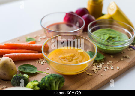 vegetable puree or baby food in glass bowls - Stock Photo