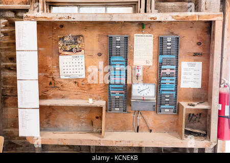 Punch clock and time cards inside the Claybank Brick Plant National Historic Site of Canada in Saskatchewan - Stock Photo