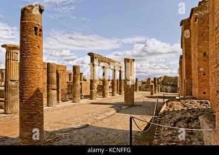 Columns at the Forum area in the ruined Roman city of Pompeii at Pompei Scavi near Naples, Italy. Mount Vesuvius - Stock Photo