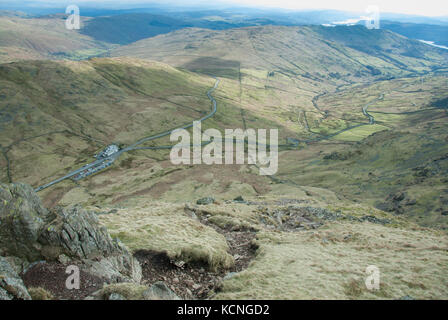 Kirstone Inn and Kirkstone Pass seen from descent of Red Screes, near Ambleside, Lake District, UK - Stock Photo
