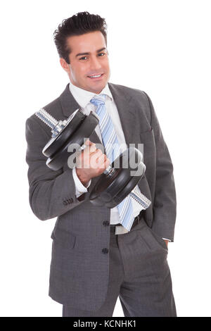 Portrait Of Young Businessman Exercising With Dumbbells - Stock Photo