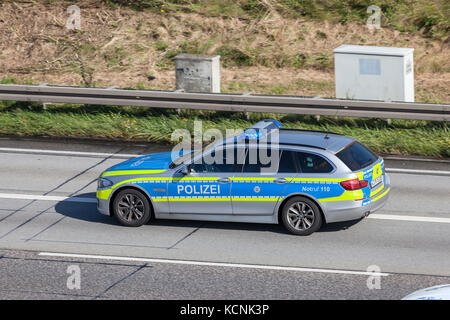 Frankfurt, Germany - Sep 19, 2017: BMW five series police car driving on the highway in Germany - Stock Photo