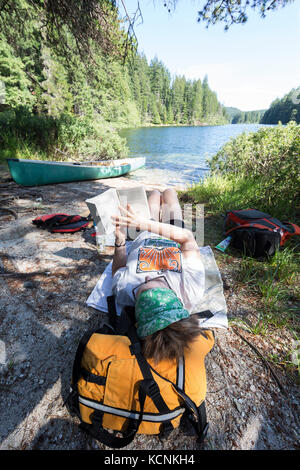 Relaxing while Canoeing on Village Bay Lakes on Quadra Island, British Columbia, Canada. - Stock Photo