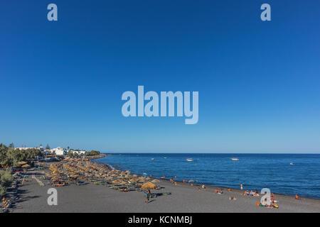 SANTORINI/GREECE 05 SEP - Kamari beach in Santorini, Greece. - Stock Photo