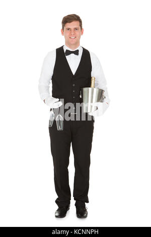 Waiter Holding A Wine Cooler With A Bottle Of Champagne And Champagne Glass - Stock Photo