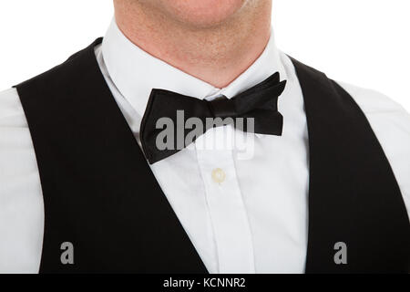 Close-up Of A Man Dressed In A Suit With Bow Tie Over White Background - Stock Photo