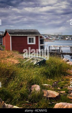 old Fishing stage and dorey, view of famous fogo island inn in distance, Joe Batt's Arm, Fogo Island, NL - Stock Photo
