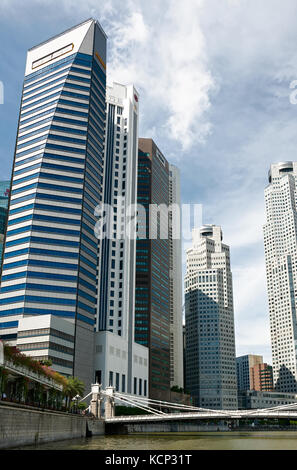 SINGAPORE - SEPTEMBER 20, 2010 - High-rise office building on the banks of the river - Stock Photo