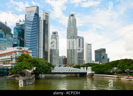SINGAPORE - SEPTEMBER 20, 2010 - View of Cavenagh Bridge, skyscrapers of the business district and the Fullerton - Stock Photo