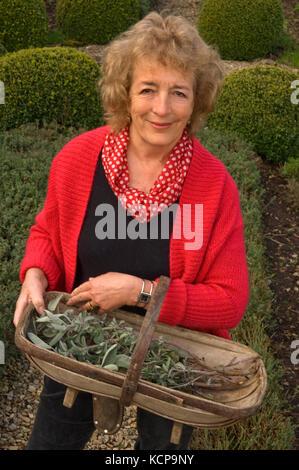 Gardener, author, broadcaster Judith Hann in her herb garden. - Stock Photo