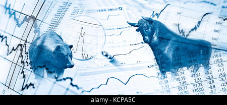 Bull, bear, charts and stock charts as symbols for the stock exchange - Stock Photo