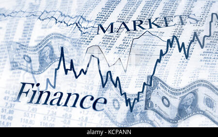 Tables with stock prices, charts and dollar bills - Stock Photo